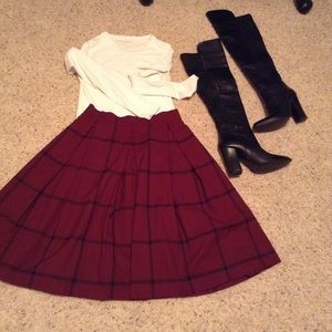 Pleated knee length brick red & black plaid skirt